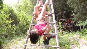 Nikita Bellucci roped outdoors
