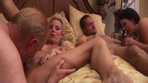 Group sex along with shaved swinger Sophie Dee