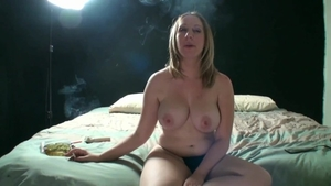 Blonde haired Jules Sterling smoking after interview